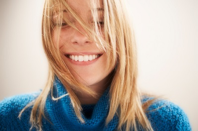 Smiling blonde woman with beautiful, healthy teeth