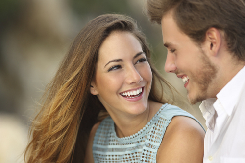 Smiling couple with beautiful teeth thanks to David R. Moyer Cosmetic & Family Dentistry