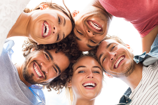 Happy patients with veneers at David R. Moyer Cosmetic & Family Dentistry